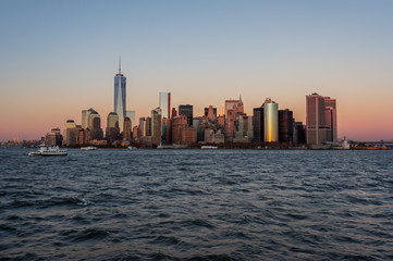 New York city skyline sunset view from the boat to Ellis Island