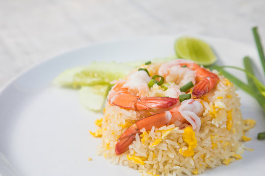 Fried rice with shrimp on the wooden table from top view