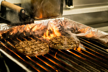hamburger beef patty grilled meat and cheese on a barbecue grill fire