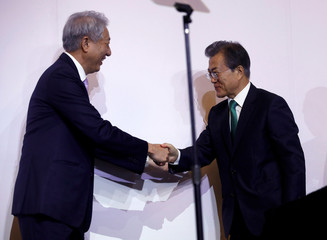 South Korea's President Moon Jae-in shakes hands with Singapore's Deputy Prime Minister Teo Chee Hean before speaking at the ISEAS 42nd Singapore Lecture in Singapore