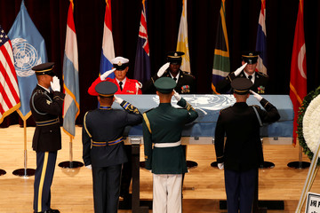 South Korean and United Nations Command (UNC) honor guards salute the remains of the United Nations Command (UNC) and South Korean soldiers who were killed in North Korea in the 1950-53 Korean War during the mutual repatriation ceremony