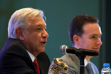 Mexico's President-elect Andres Manuel Lopez Obrador talks to the media as Chiapas Governor Manuel Velasco listens during a news conference after a private meeting with state governors in Mexico City