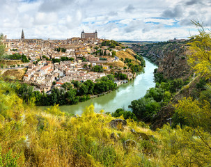 Panoramic view of the historic city of Toledo with river Tajo, Spain.