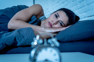 pretty latin woman can't sleep in insomnia concept
