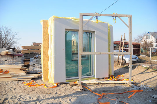 Modular frame plywood board panel walls house on the home construction site. Structural insulated panels house installation.