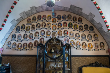 An image of the genealogy of famous historical figures as well as museum exhibits and furniture