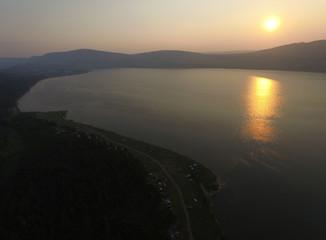 An aerial view shows Lake Uchum during sunset in Krasnoyarsk Region