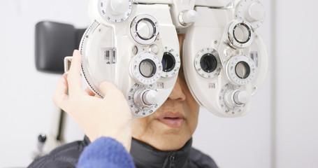 Old man undergo eye test