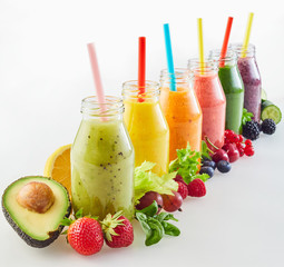 Different fresh fruit smoothies with ingredients
