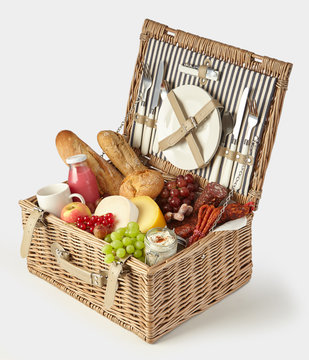 Old vintage style picnic hamper packed with food