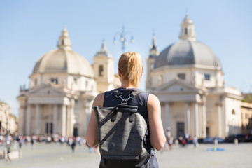 Female tourist with a fashinable vintage hipster backpack on Piazza del Popolo, People's Square, in Rome, Italy.