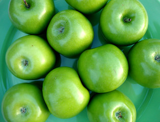 diet for a beautiful figure. dietary food. diet. recipe of health. strong teeth and gum. green apples on a plate.