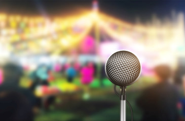 Illustration of the microphone isolated on the blurry image of the stage in the meeting celebration festival during a night show abstract background.