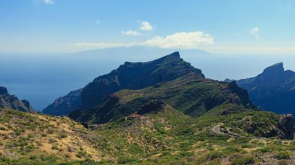 Sight on mountain and La Gomera island from Tenerife, near Masca village.