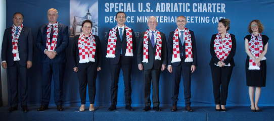 U.S. Secretary of Defence James Mattis poses for a family photo with defence ministers wearing Croatian football scarves during the Special U.S. Adriatic Charter Defence Ministerial Meeting (A5) in Zagreb