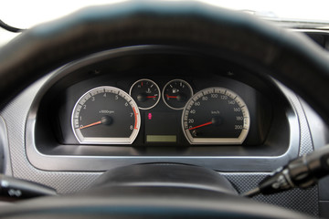 speedometer and tachometer on the dashboard of the car