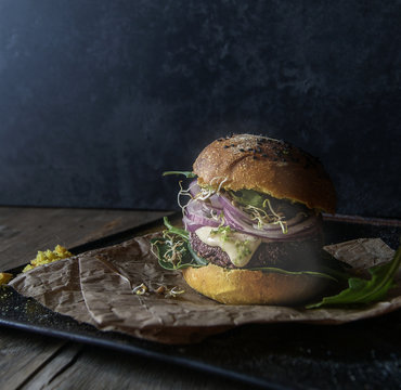 Tasty hamburger with lentil and purple carrot