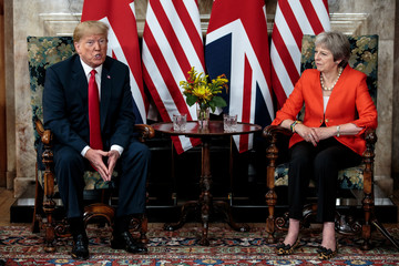 Britain's Prime Minister Theresa May poses for photographs with U.S. President Donald Trump at Chequers near Aylesbury