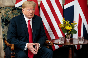 U.S. President Donald Trump poses for photographs with Britain's Prime Minister Theresa May at Chequers near Aylesbury