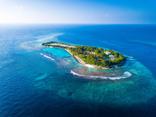 Aerial view of the tropical island in the middle of the Indian Ocean. Maldives