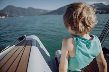 Boy sitting on a sailing boat