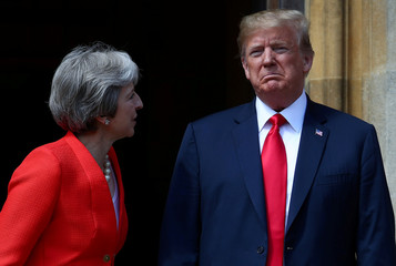 Britain's Prime Minister Theresa May poses for a photograph with U.S. President Donald Trump at Chequers near Aylesbury