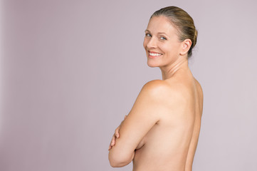 Foto op Canvas Akt Senior woman standing naked