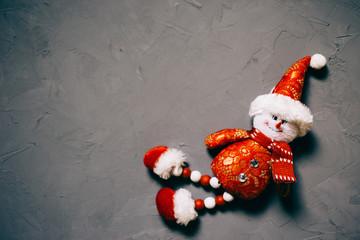 toy snowman on dark textured background, copy space