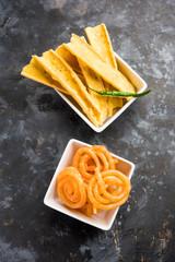 Crispy Fafda with sweet jalebi is an Indian snack most popular in Gujarat, selective focus