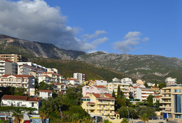 Coastal city at the foot of the mountain. Becici, Montenegro, View of the city and mountains