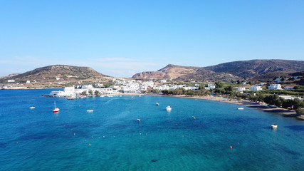 Aerial drone bird's eye view photo of picturesque fishing village of Polonia with traditional fishing boars docked next to island of Kimolos, Milos island, Cyclades, Greece