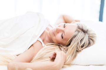 Woman in the bed don't want to wake up in the morning