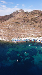 Aerial drone bird's eye view photo of picturesque and colourful fishing village of Klima with traditional character and uphill village of Plaka at the background, Milos island, Cyclades, Greece