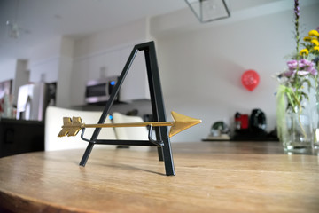 Tiny metallic easel with gold arrow