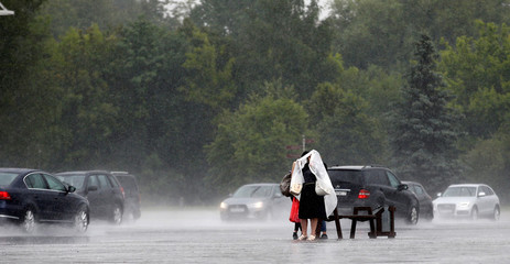 Women waiting for a bus during heavy rain in central Minsk