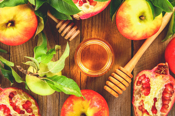 Rosh hashanah jewish New Year holiday concept. Traditional symbol. Apples, honey, pomegranate. Top view. Flat lay.