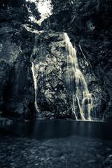 waterfall at river in dark colors