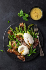 asparagus, avocado, poached egg and fried bacon  salad