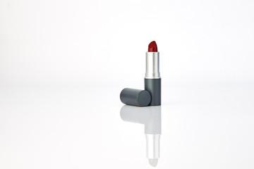 red lipstick on white