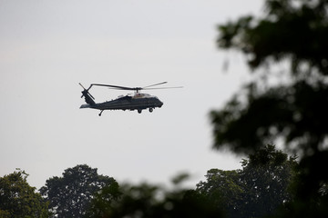Marine One helicopter carrying U.S. President Donald Trump arrives in Windsor where Trump is due to meet Britain's Queen Elizabeth at Windsor Castle, Windsor