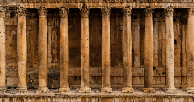 Frontal view of a colonnade - Row of columns of an ancient Roman temple ruin (Bacchus temple in Baalbek)