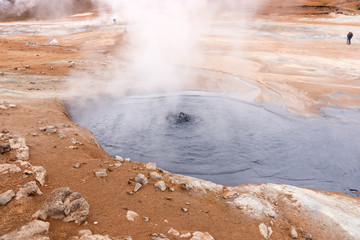 Hot gray mud pots in the geothermal area Hverir in Iceland