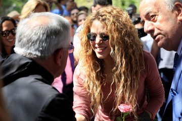 Colombian singer Shakira is greetied by a priest during her visit to Tannourine Cedars Reserve, in Tannourine