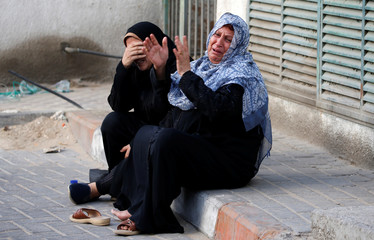 Relatives of Palestinian Othman Helles, who was killed at the Israel-Gaza border, react in Gaza City