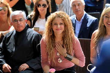 Colombian singer Shakira reacts during her visit to Tannourine Cedars Reserve, in Tannourine
