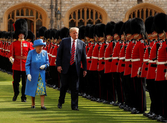 U.S. President Donald Trump and Britain's Queen Elizabeth inspect the Coldstream Guards during a visit to Windsor Castle in Windsor