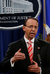 Deputy U.S. Attorney General Rosenstein holds news conference to announce indictments in special counsel Robert Mueller's Russia investigation at the Justice Department in Washington