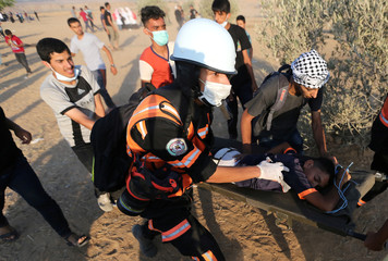 Wounded Palestinian is evacuated during a protest at the Israel-Gaza border in the southern Gaza Strip
