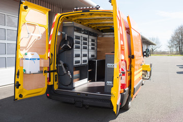 Rear view of mobile van workshop with doors open