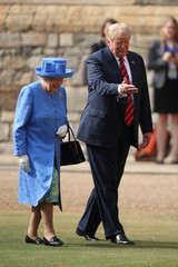 Britain's Queen Elizabeth inspects an honour guard with U.S. President Donald Trump at Windsor Castle, Windsor